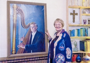 The artist with her portrait of David Watkins